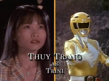 The screen credits for Thuy Trang on Mighty Morphin Power Rangers, along with images of Trang as Trini Kwan (left) and her Power Rangers counterpart, the Yellow Ranger (right). A screenshot of Thuy Trang's screen credit as Trini the Yellow Ranger on the television series Mighty Morphin Power Rangers.jpg