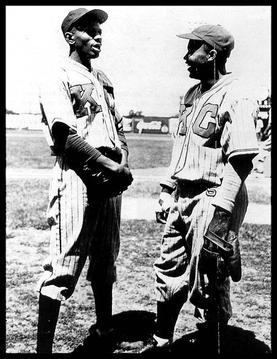 Paige (left) and Jackie Robinson in the uniform of the Kansas City Monarchs, 1945