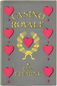 "A book cover: down the left and right sides are representations of hearts, four on each side, each one with a drop of blood below them. In the centre of the image is another heart but without the blood drop. This central heart is surrounded by a gold laurel leaf bearing the words ""A whisper of Love, A Whisper of Hate"". Above the heart / laurel is the title, Casino Royale; below the heart / laurel are the words ""by Ian Fleming"""