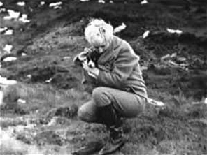 In this photograph taken by Brady, Hindley crouches over John Kilbride's grave on Saddleworth Moor with her dog, Puppet, in November 1963. Myra at John Kilbride's grave.jpg