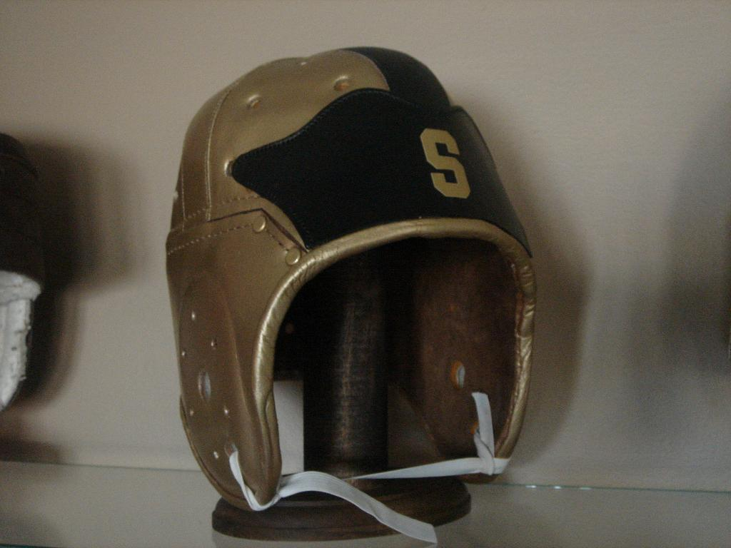 19b05f482f0 A full-size replica of the 1933 Michigan State gold and black winged helmet