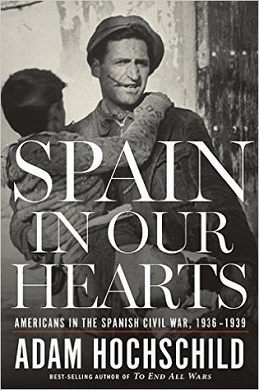The first edition cover of Spain in Our Hearts shows a vintage photograph of an adult man carrying a young boy in his arms during the Spanish Civil War.