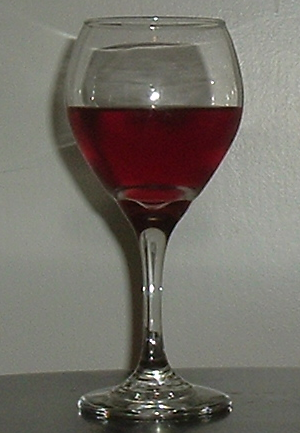 A glass of rosé wine. The color is deeper than...