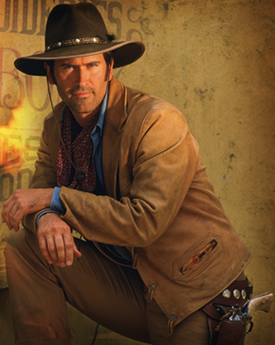 An image of a cowboy, leaning with his arms on his right knee. A revolver pistol is holstered on his left hip.