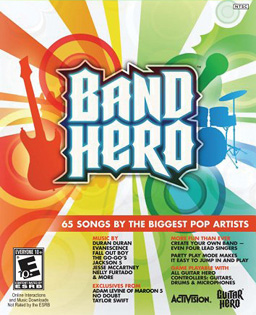 "The game's logo ""Band Hero"" sits in the center of a white background, with a rainbow of colors beams going out to the edges; figures of a guitar, drum kit, and microphone are placed around the logo within the rainbow color scheme. Text details about the game (included bands and songs) are listed at the bottom right of the box."