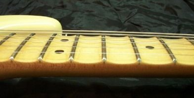 Scalloped maple fretboard on a YJM Strat Scalloped fretboard.jpg