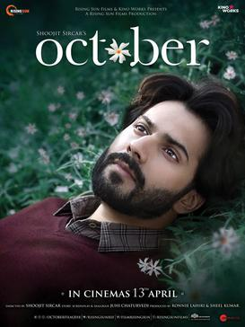 The poster features face of Varun Dhawan laid on the grass. The film title appears on top.