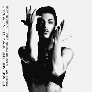 "A black a white photo of a man with a black tank top and his arms posed in a theatrical way with the words ""PRINCE AND THE REVOLUTION/ PARADE"""
