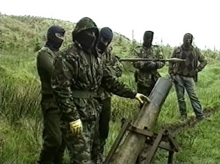 This screenshot shows an IRA unit loading an improvised mortar in 1992