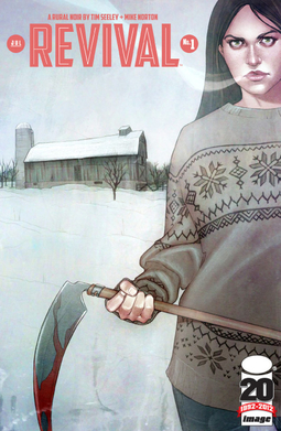 In the foreground, dark-haired college student Em holds a bloody scythe and is glaring at the viewer. The background is a snowy rural landscape with an old barn.