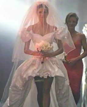 "Composite image of the wedding dress from the ""November Rain"" music video worn by Stephanie Seymour. November-rain-dress.jpg"