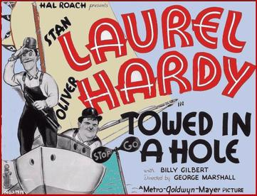Image result for laurel and hardy towed in a hole