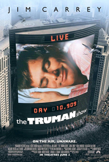 the truman show the truman show film poster on the side of the building is a large screen showing a