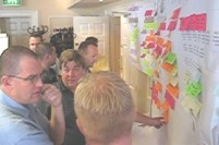 Intense discussion during a programme compression workshop.jpg