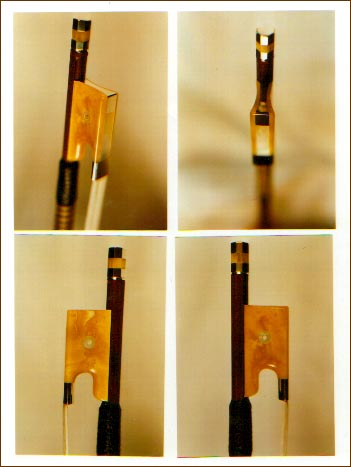 An amber violin bow frog, made by Keith Peck in 1996/97.
