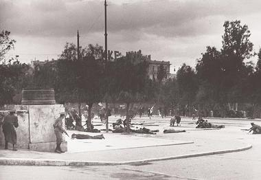 Unarmed protesters of EAM lying dead or wounded on 3 December 1944 in front of the Greek Parliament, while others are running for their lives; moments after the first shootings that left at least 28 dead and signalled the beginning of the Dekemvriana events. Dekemvriana 1944 SYNTAGMA.jpg