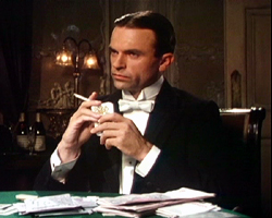Sam Neill portraying Reilly in the TV miniseries Reilly, Ace of Spies (1983).