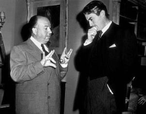 Alfred Hitchcock and Gregory Peck in discussion on the set of The Paradine Case