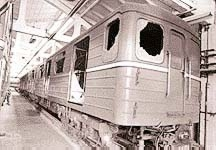 One of the metro cars after the accident, with broken windows to make way for the escape.