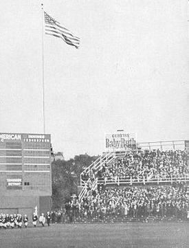 "The Baby Ruth sign outside Wrigley Field, as seen during the 1935 World Series, three years after the ""Called Shot"". Note the 440 marker in the center field corner. Ruth's hit went to the right of it and farther back."