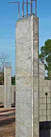 Concrete columns curing while wrapped in plastic