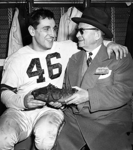 Lou Groza and owner Mickey McBride after a December 1950 playoff game against the New York Giants. Groza's kicking played a major role in the team's first NFL championship.