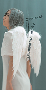The picture has Ayumi Hamasaki wearing an Angel costume, with angel wings. She is pictured in front of a blue backdrop, alongside the text and her name superimposed on the image.