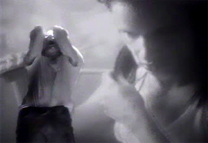 Reznor in front of a projection screen, showing a clip featuring Juliette Lewis from Natural Born Killers Burn music video.jpg