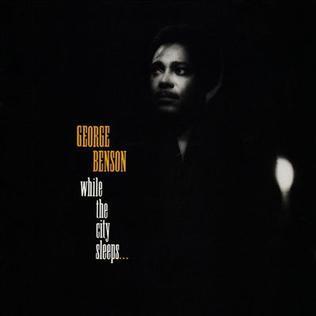 <i>While the City Sleeps...</i> 1986 studio album by George Benson