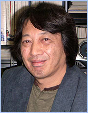 A photograph of Comiket's co-founder and president, Yoshihiro Yonezawa.