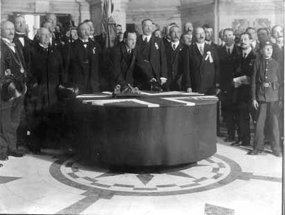 "Edward Carson signing the Solemn League and Covenant in 1912, declaring opposition to Home Rule ""using all means which may be found necessary"" Carson signing Solemn League and Covenant.jpg"