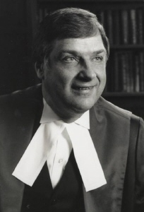 Black and white portrait of Kryczka in judicial robe with white collar
