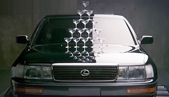 Lexus television debut with champagne glasses stacked on the hood of a revving LS 400