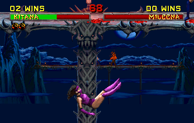 A screenshot of Pit II's Stage Fatality being performed against Mileena. A figure in flames later retconned as Blaze can be seen in the stage's background (see also the rumors section) Mortal Kombat II Pit II.png
