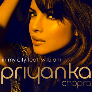 """A photograph showing the face of a young, Indian woman from the left profile against a black background. At the foot of the image are the words """"In My City feat. will.i.am """" and """"Priyanka""""."""
