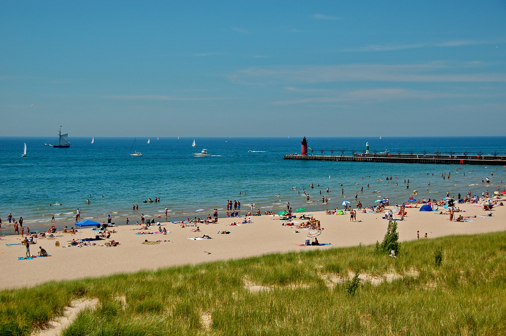 South Haven, MI is better for the beach itself, about 30 minutes from