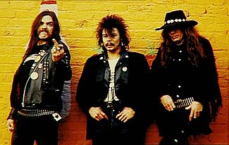 "The 1976–1982 Motörhead line-up: Lemmy Kilmister, Phil ""Philthy Animal"" Taylor and ""Fast"" Eddie Clarke Lemmy-taylor-clarke.JPG"