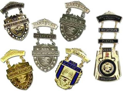 Examples of the NRA's Winchester/NRA Marksmanship Qualification Badges with shotgun and pistol clasps on the NRA Distinguished Expert Badge.