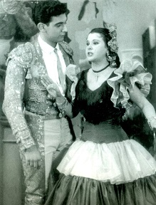 Seventeen-year-old Plácido Domingo as the tenor Rafael the bullfighter in El gato montés with Rosa Maria Montes (Mexico City, 1958)
