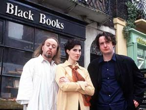 The three main characters of Black Books. Left...