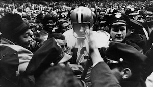 Cleveland quarterback Frank Ryan is mobbed after the 1964 championship.