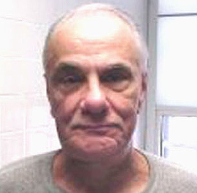 [Last photo of John Gotti, taken by the Bureau of Prisons on October 17, 2001.]