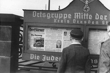 Boys in front of a Sturmerkasten, the public stands in cities featuring Der Sturmer during the Nazi era in Germany USHMM 64415.jpg
