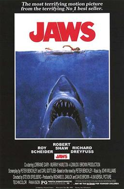 "Movie poster shows a woman in the ocean swimming to the right. Below her is a large shark, and only its head and open mouth with teeth can be seen. Within the image is the film's title and above it in a surrounding black background is the phrase ""The terrifying motion picture from the terrifying No. 1 best seller."" The bottom of the image details the starring actors and lists credits and the MPAA rating."