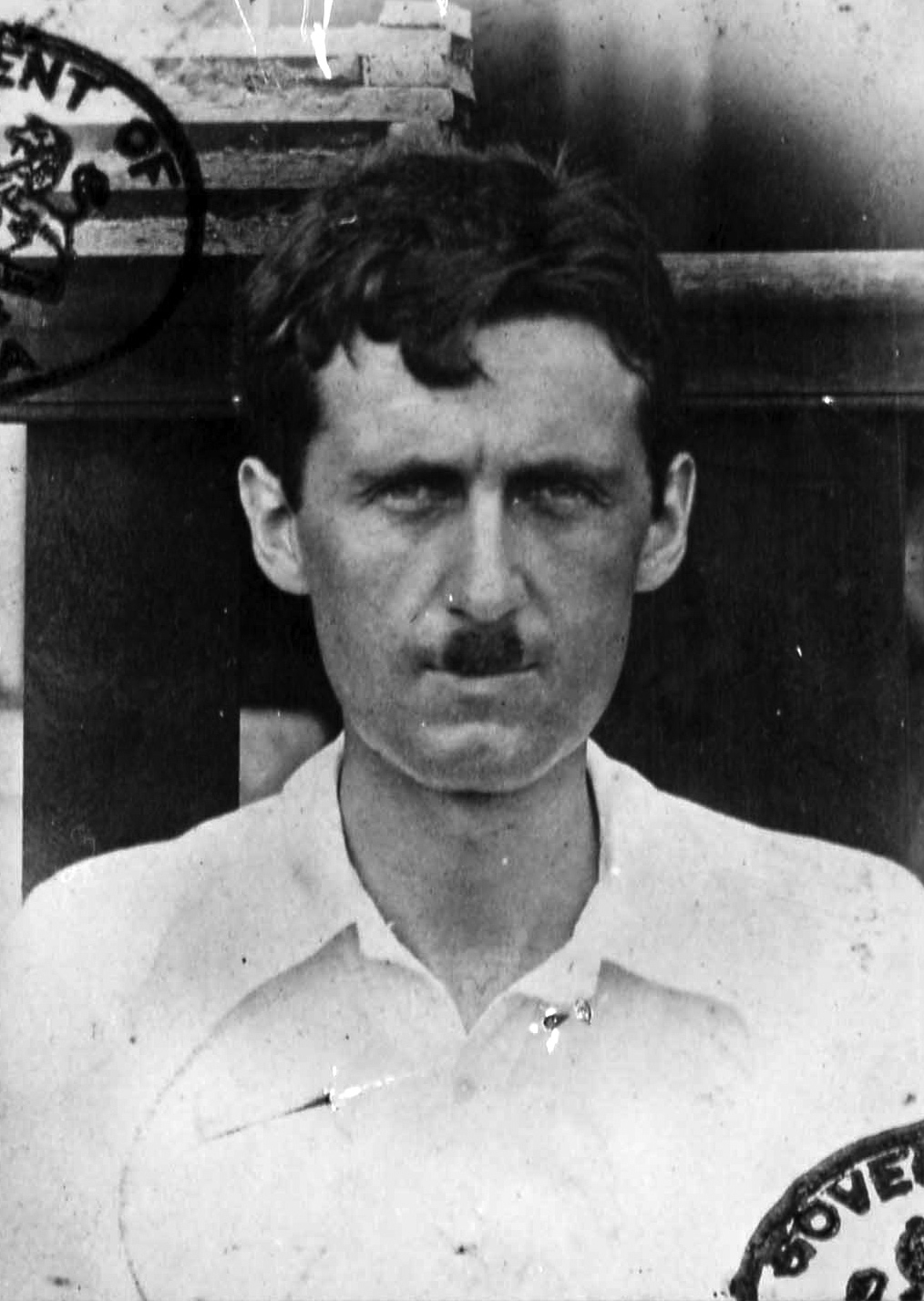 shooting an elephant  a passport photo of orwell taken during his time in the burmese police force