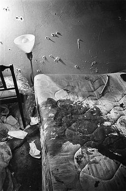 The bed and room where Hampton was fatally shot during the raid, showing a large amount of blood on his side of the mattress and numerous bullet holes in the walls. Fred Hampton murder scene bedroom bloody mattress.jpg