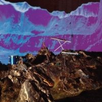 Album cover collage with an artistic blue mountain range in the background and a brown/grey rocky landscape containing a guitar, a drum, two keyboards, and lengths of electrical wire in the foreground.