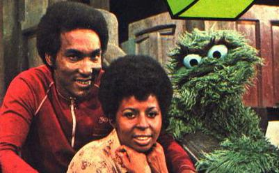 [Image: Sesame_Street_Hal_Miller_as_Gordon_with_..._Oscar.jpg]