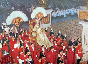 Pope Pius XII, wearing the traditional 1877 Papal tiara, is carried through St. Peter's Basilica on a sedia gestatoria c. 1955. GestatorialChair1.jpg