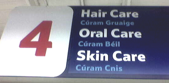 A bilingual sign in a Tesco supermarket in Dublin, Ireland. Note the smaller, shaded-out Irish language text compared to the prominent English text